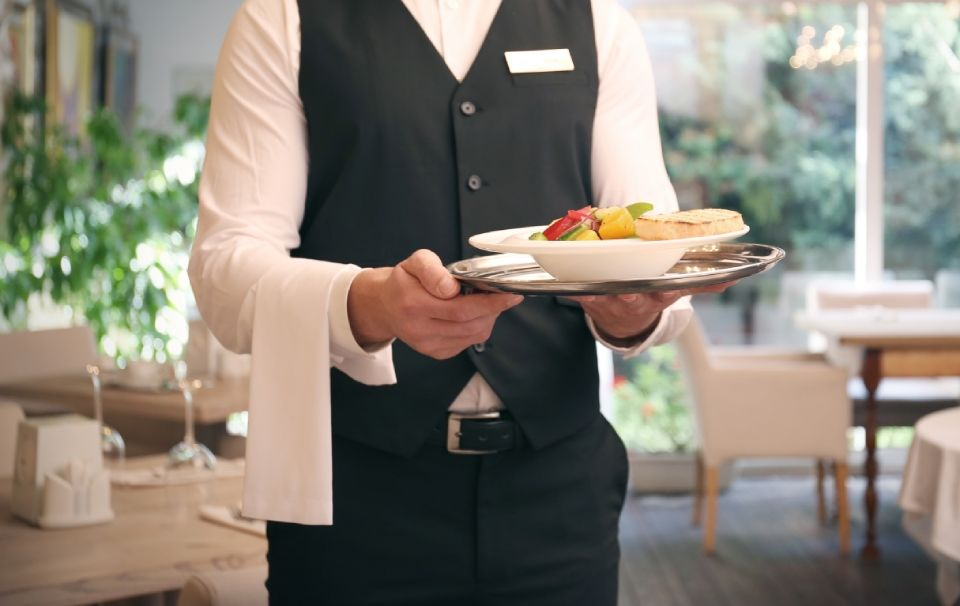 waiter holding a dish
